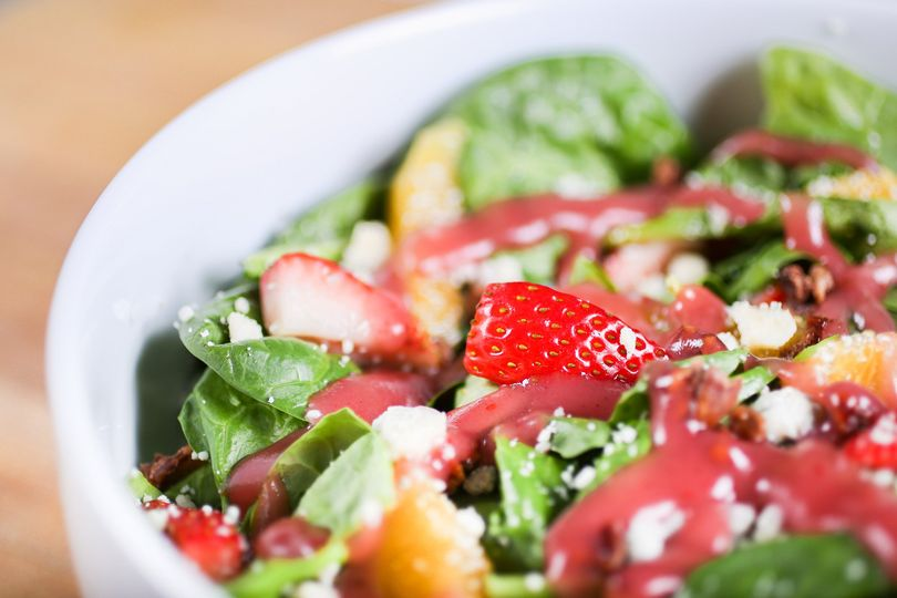 Summer spinach salad with strawberries, mandarin orange slices, and raspberry vinaigrette