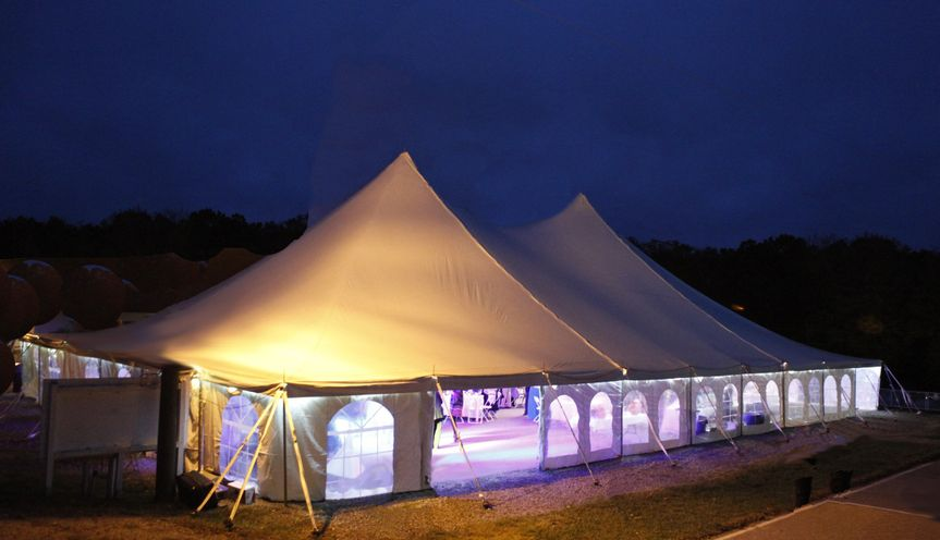 Reception tent at night.