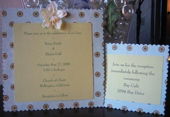 This invitation is wrapped in vellum and a ribbon.