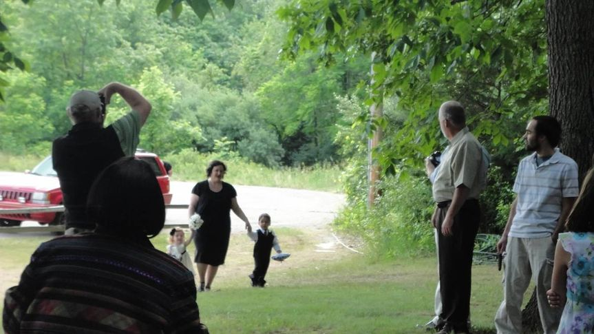 Laura and Logan joining the wedding procession.