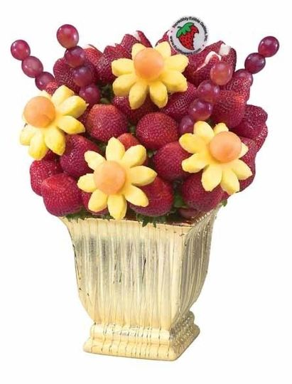 This decadent vase is filled with delicious fresh cut Pineapple Daisies & Strawberry Roses!...
