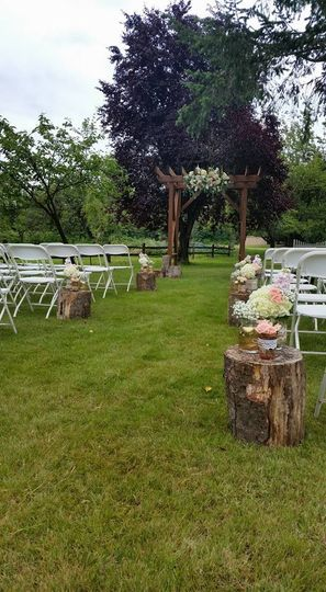 a ceremony on the back lawn with your own arch