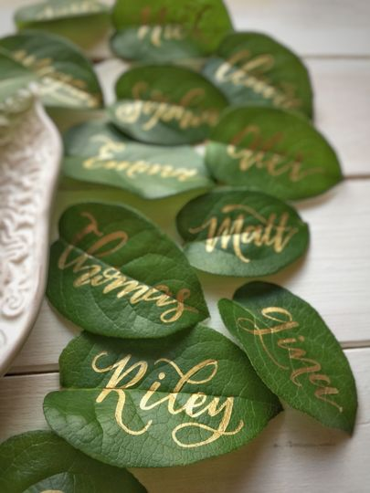 Creative name cards can be anything! Can't ever go wrong with greenery!