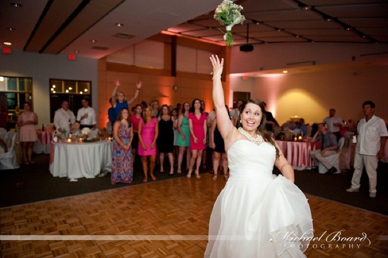 Throwing her bouquet