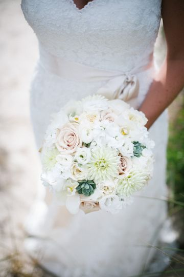 White and cream garden variety flowers combine to create a bouquet of wondrous beauty and sweetness.