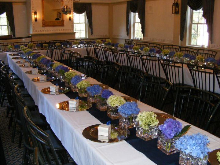Simple and impressive, a row of hydrangea blooms in blues, purples and green makes a statement.