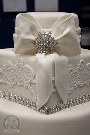 Wedding cake with ribbon topping