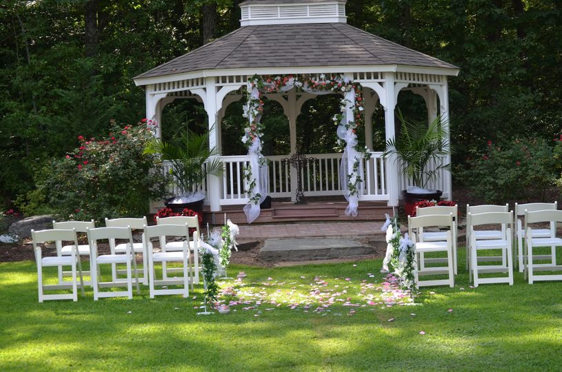 gazebo ceremony garden with white wooden chairs set up for small group