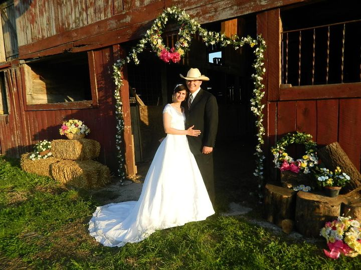 Wedding couple, Jessica and Justin, in front of the northwest entrance to the Wedding Barn at Civil...