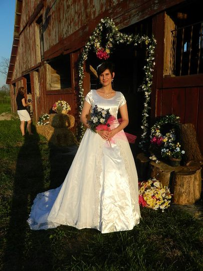 Beautiful bride Jessica in front of the Wedding Barn at Civil War Ranch in Carthage, MO. Photo by...