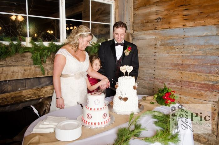 Cutting of the wedding cake inside the Wedding Barn, just inside the main north entrance at the...