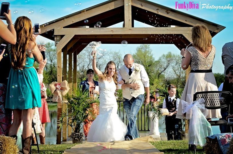 Ashlea and Matt after their wedding ceremony on the dock of the Ranch Pond at the Civil War Ranch in...