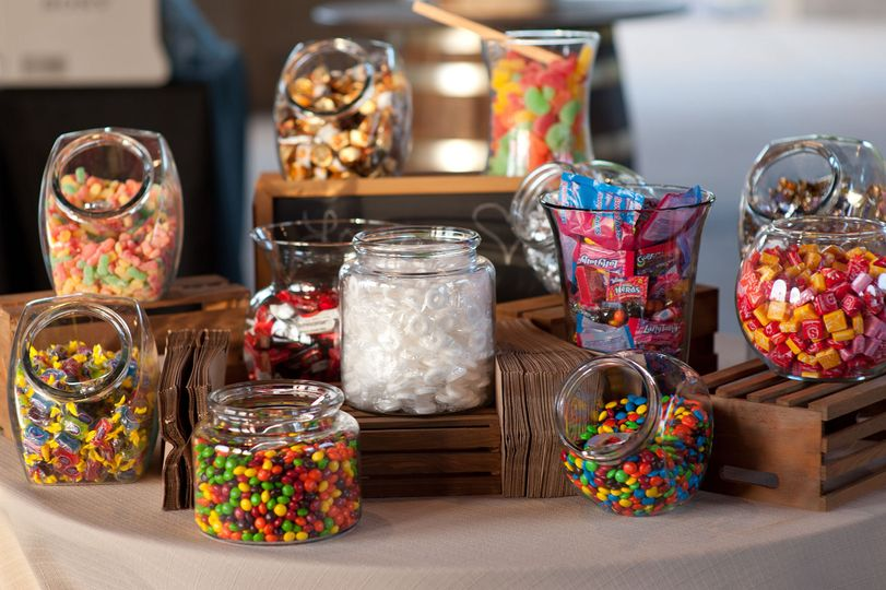 A dessert table with candy jars