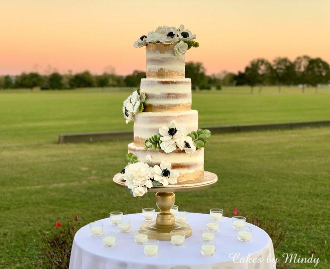 semi naked wedding cake with sugar flowers4 51 980188 158129771745675