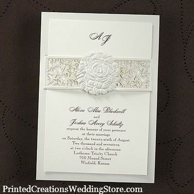 A lacy floral band around a traditional invitation