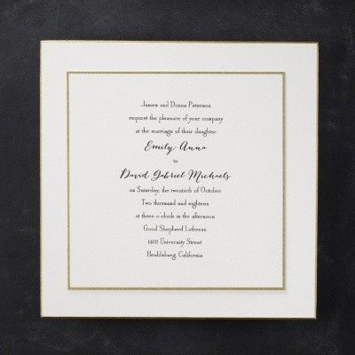A gold bordered invitation inset into a beveled gold card