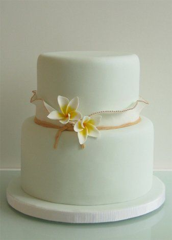 Simple stylish cake accented with frangipani