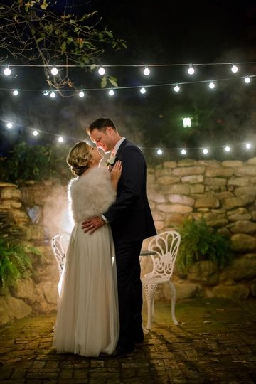Couple kiss under the string lights