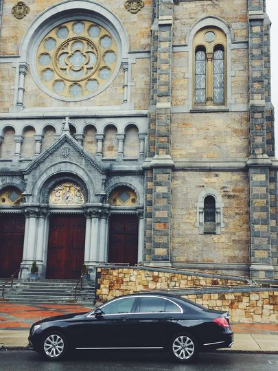 Mercedes in front of church
