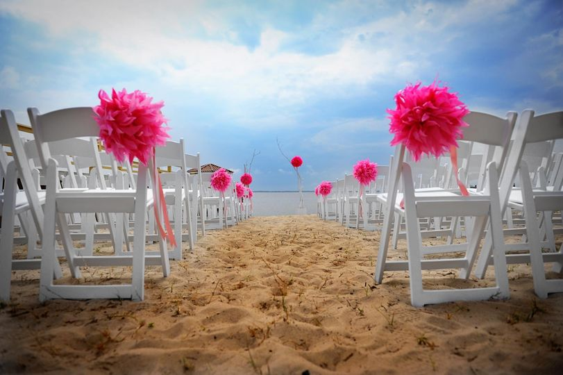 Pink flower decor for the wedding chairs
