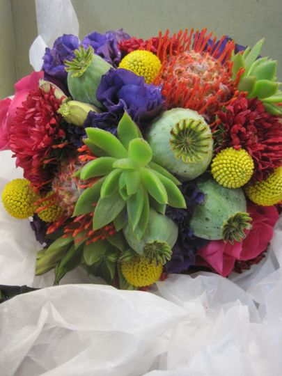 Hot colors and unusual succulents, protea, poppies and billy balls make for an interesting bouquet...