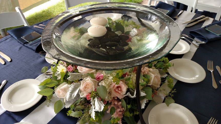 Floating candles in Waukesha Floral's rental bowl