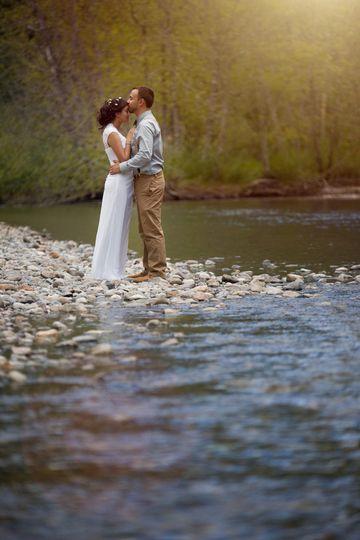 couples portrait on river