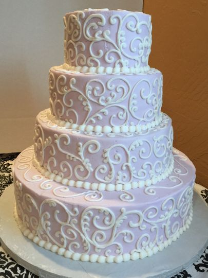 Four tier scroll on pink with Très Chic Bakery