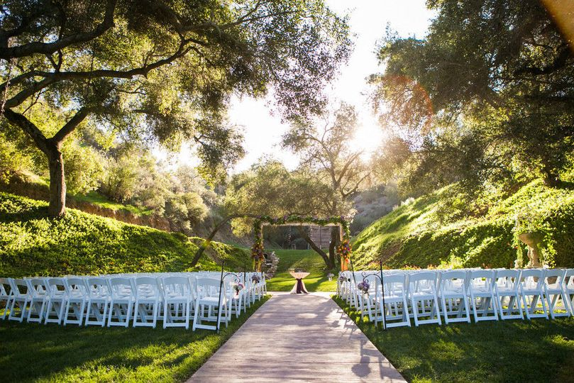 e0277a599f437071 1457373745616 meadow ceremony empty chairs