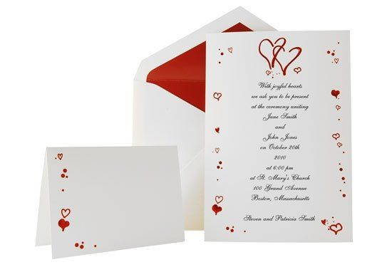 Red embossed hearts frame this beautiful radiant white single card. A true classic! For reception...