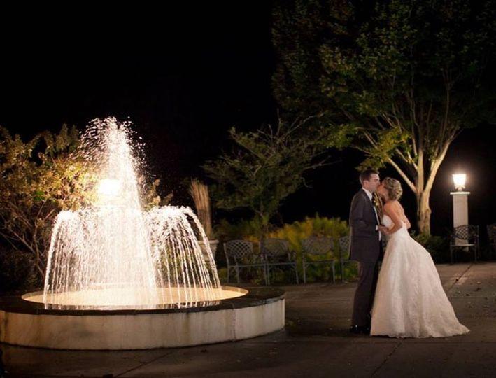 Fountain and lit coach lanterns