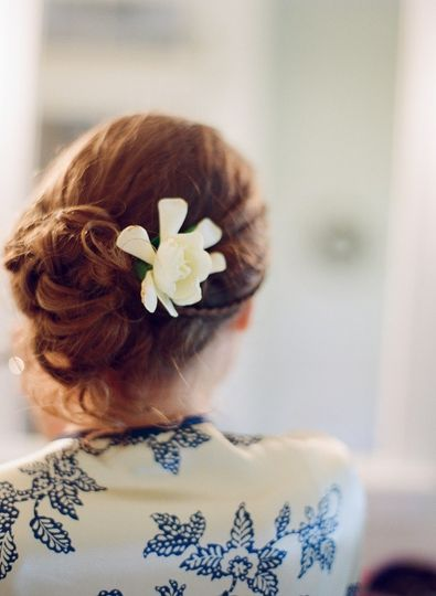 Updo with white flower