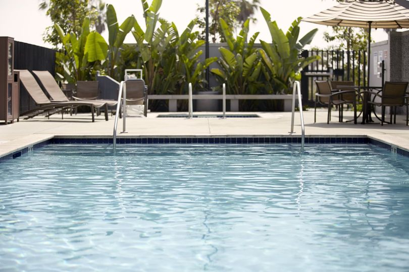 Outdoor swimming pool open year round open 6:00 a.m. to 10:00 p.m.