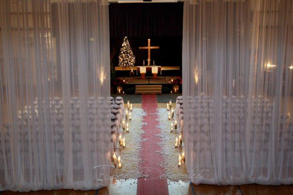 Events Decorated - December Wedding Ceremony.  Sheer white drape, chair covers and sashes, aisle...