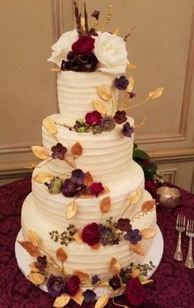 White cake decorated with flowers and leaves