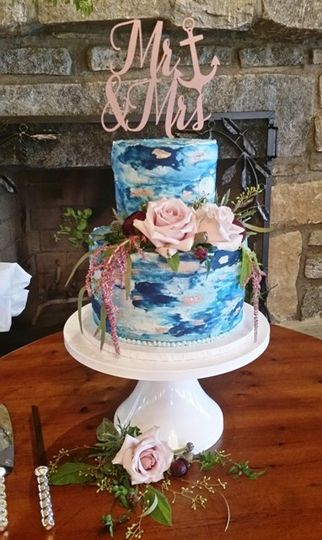 Blue textured cake with peach roses