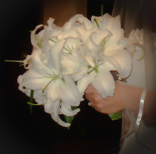 Perfectly white fragrant Casablanca lilies, what can be more attention grabbing?......only a...