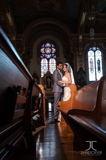 A quiet moment after the ceremony to reflect on their new lives together.