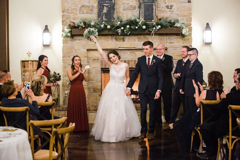 Landon & Kendra chose to get married by the fireplace inside. (Photograph by Cat Satre Photography)