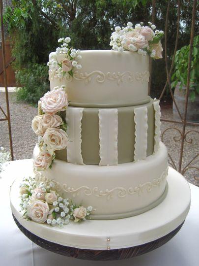 3-tier wedding cake with striped middle layer