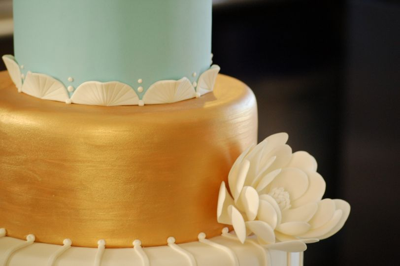 Blue, gold, and white wedding cake