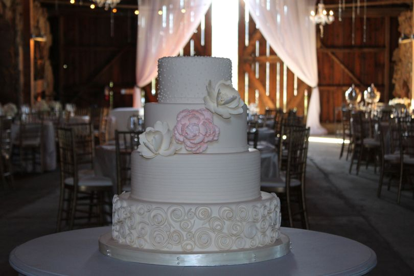 4-tier wedding cake with floral details