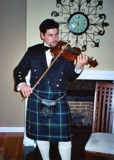 Add a little more sophistication with a violinist in a kilted tuxedo