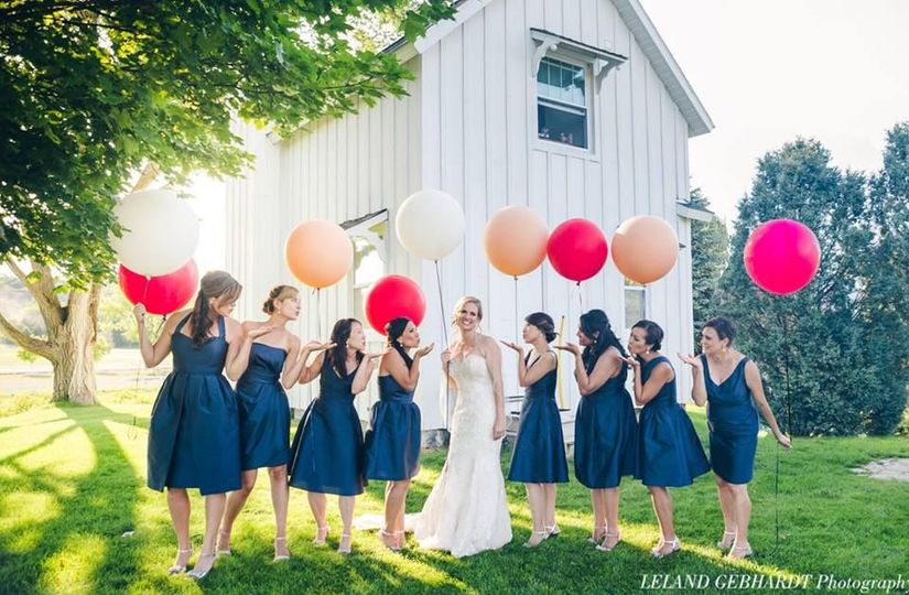 The ladies holding balloons