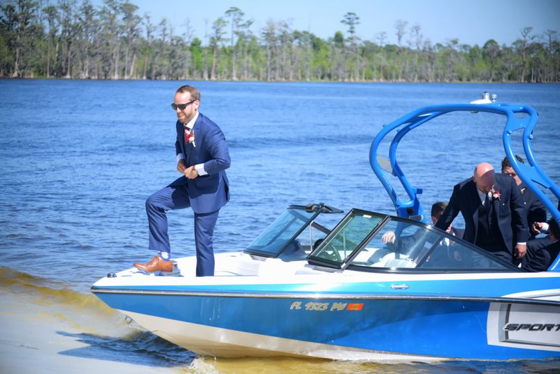 The groom's arrival by boat!