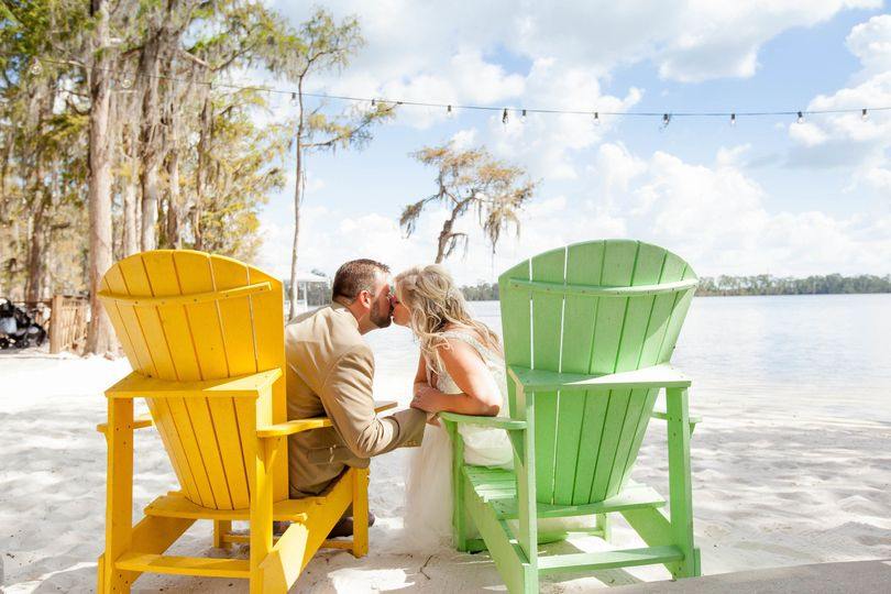 Adirondack chairs on the white sandy shores of paradise cove