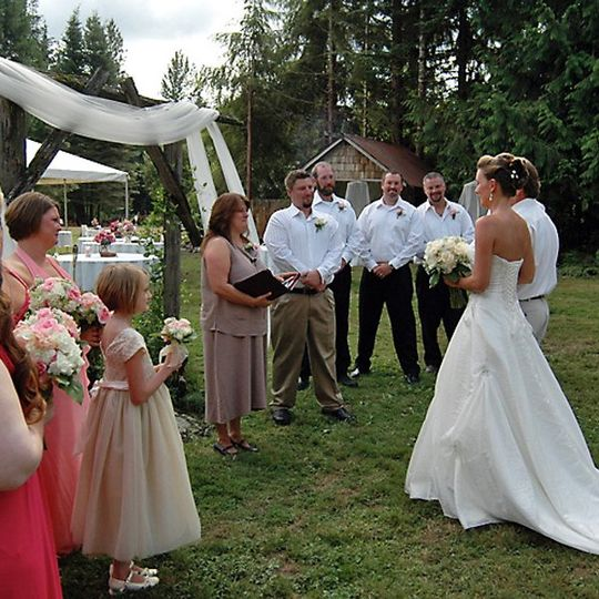 WeddingPartyOfficiateBrideGroomOutdoors