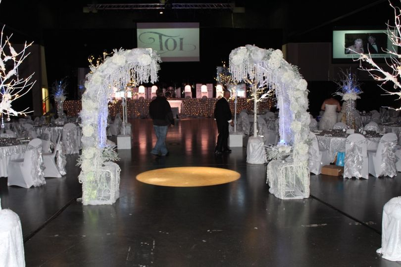 Walk through a romantic  winter wonderland archway, covered in snow and ice covered hydrangeas,...