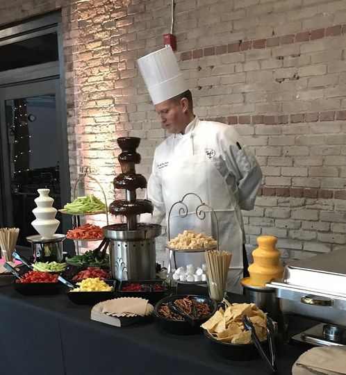 Chocolate fountain and fruits