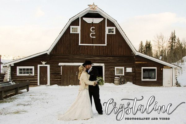 Bride & Groom kiss in front of a barn at C Lazy U Ranch